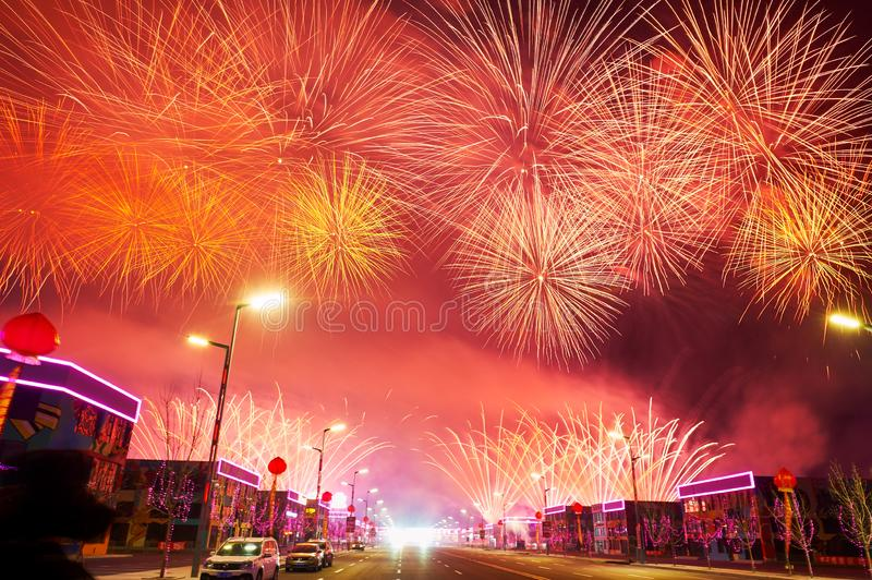 The red color fireworks reach on the Motor city. The photo was taken in Motor City of Daqing city,Heilongjiang province, China.It was setting off fireworks to royalty free stock photo