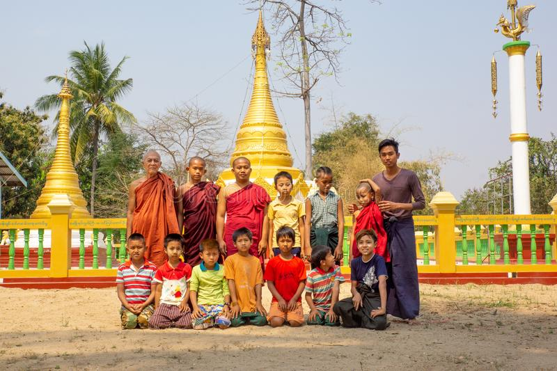 Mondalay/Myanmar-07.03.2017:The portrait of the buddhist master and his students royalty free stock image