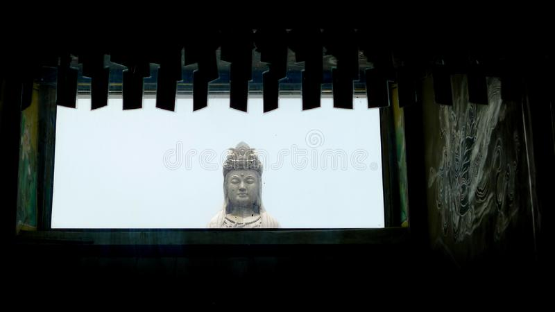 The statue of Guanyin in temple. The photo was taken during my one year trip around India stock image