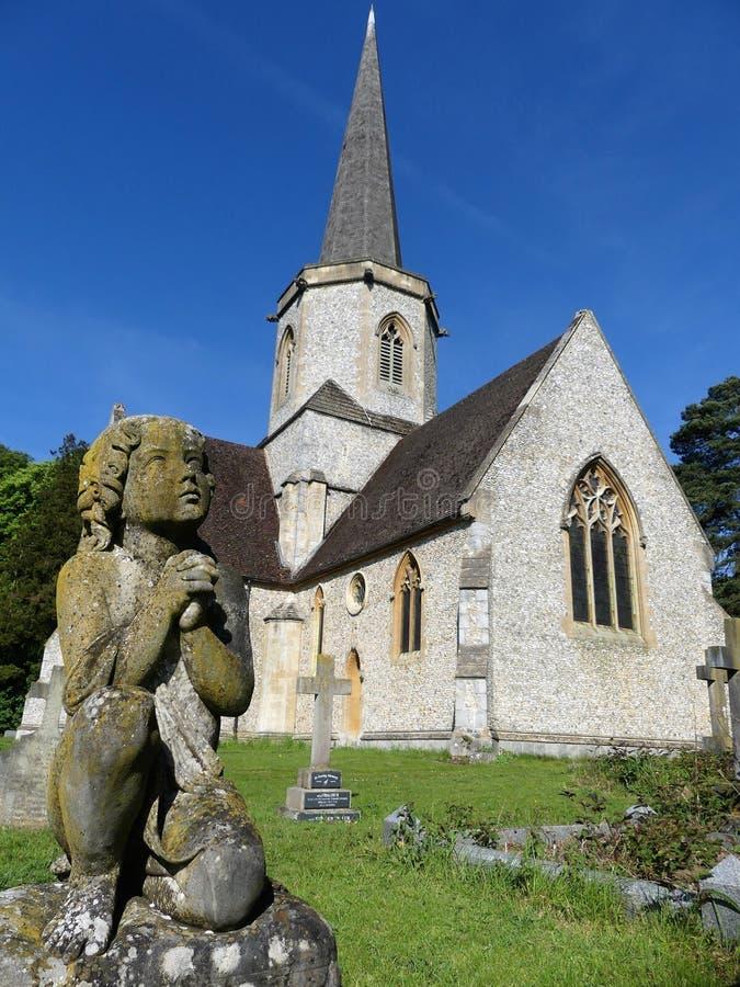 Statue of child kneeling in prayer at Holy Trinity parish church, Penn Street, Buckinghamshire, UK stock images