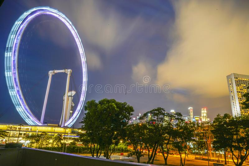 The Singapore Flyer during dusk. This photo was taken at Singapore Flyer. Long shutter was used to showcase the light rings royalty free stock photos