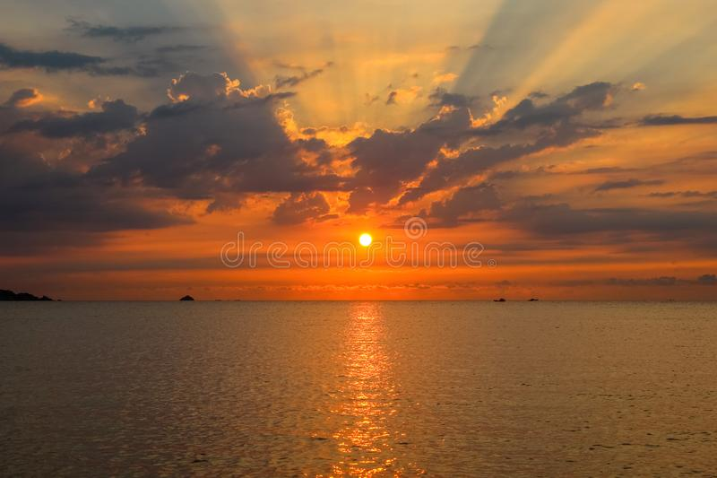 Background Seascape with The Sun, Clouds and Sunrays at Beautiful Sunrise royalty free stock photos