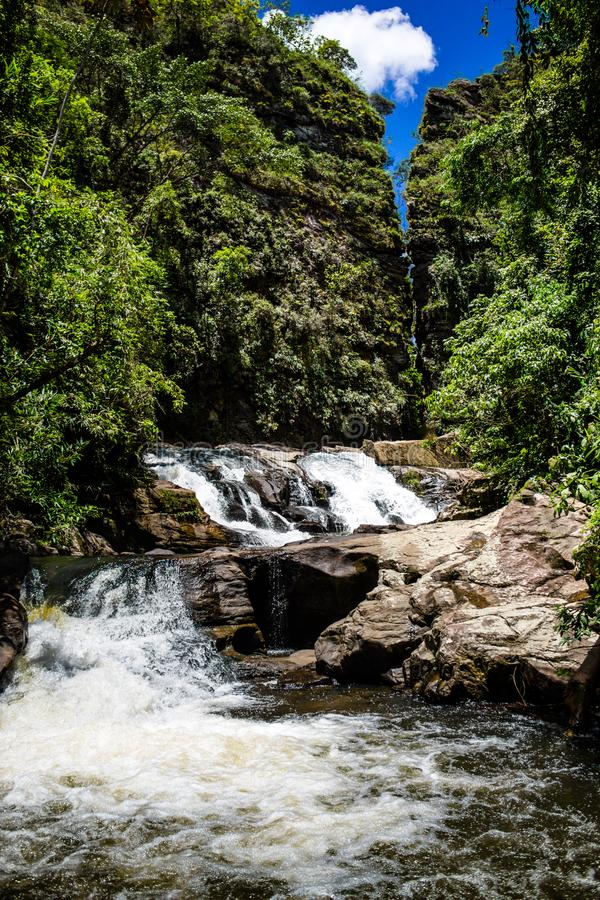 Waterfall with a bright blue sky. stock images