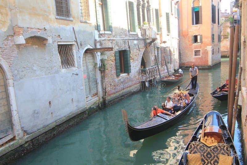 Waterway, gondola, water, transportation, boat, vehicle, watercraft, canal, channel, tourism. Photo of waterway, gondola, water, transportation, boat, vehicle royalty free stock photo