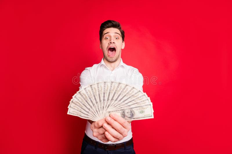 Photo of wealthy man admiring his salary payment money while isolated with red background. Photo of wealthy man admiring his, salary payment money while isolated royalty free stock image