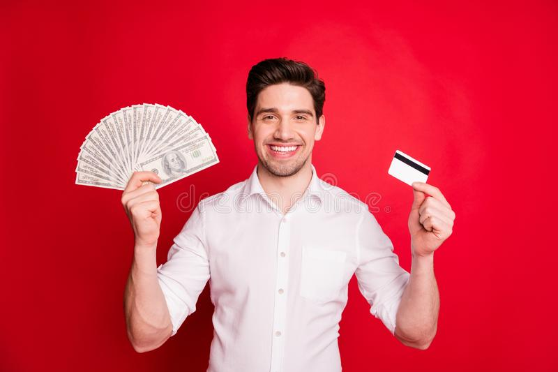 Photo of wealthy successful man enjoying having received salary fun while isolated with red background. Photo of wealthy successful man, enjoying having received stock image