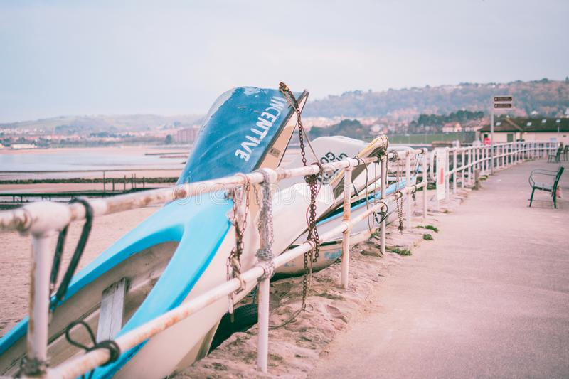 Photo of White and Blue Boats Beside White Railings royalty free stock image