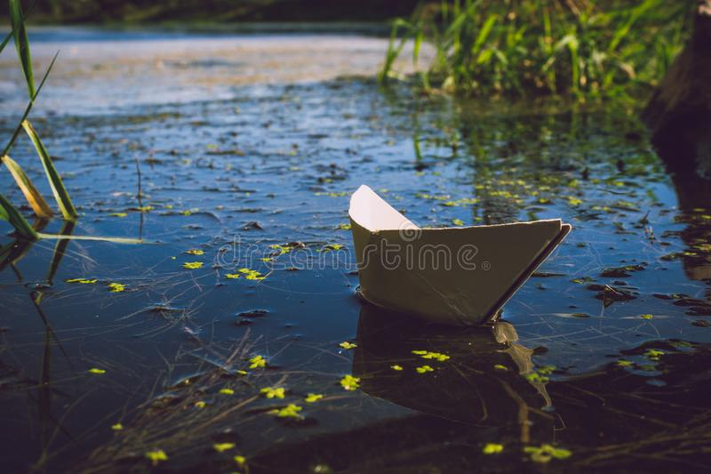 Photo of White Paper Boat on Body of Water stock photos