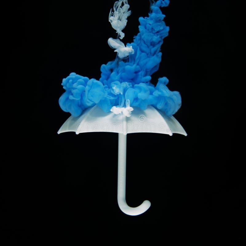 Photo of White Umbrella With Blue Smoke Illustration royalty free stock image