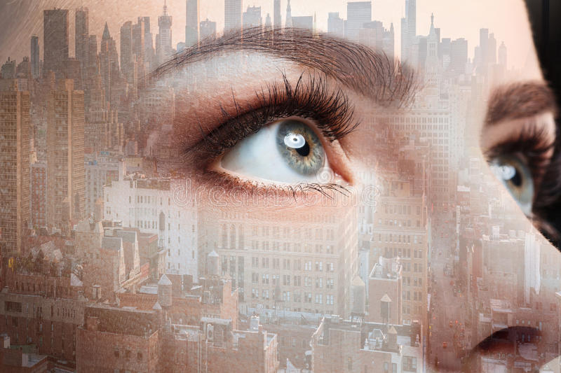 Photo of woman eye and business city. Double exposure stock photography