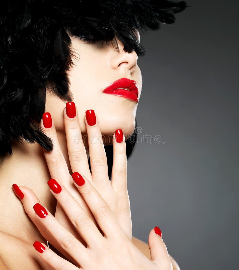 Photo of woman with fashion red nails and lips stock photography