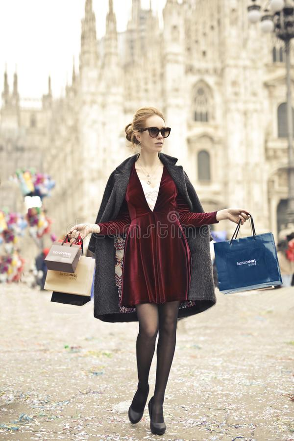 Photo of a Woman Holding Shopping Bags royalty free stock image