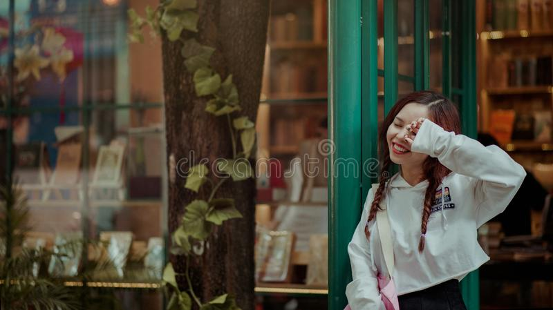 Photo of Woman Leaning on the Door stock photos