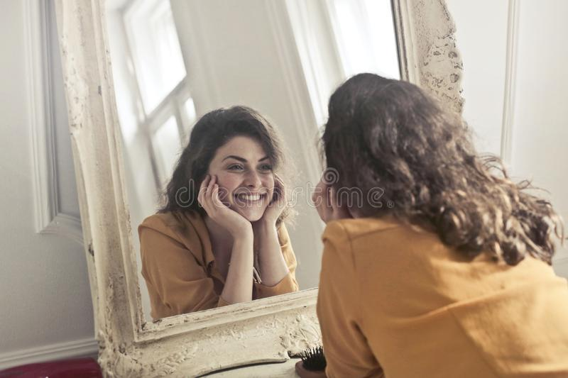Photo of Woman Looking at the Mirror stock images