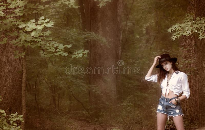 Photo of Woman Near Forest royalty free stock photo