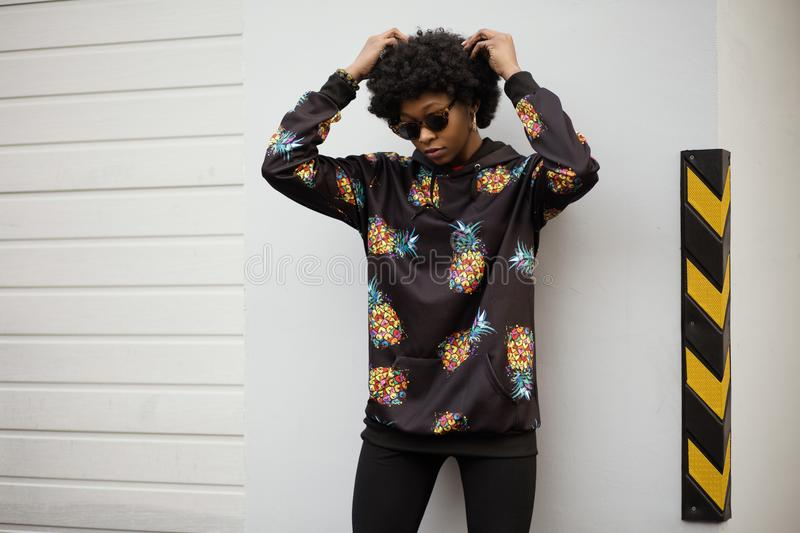 Photo Of A Woman In Pineapple Print Pullover Leaning On White Wall Free Public Domain Cc0 Image