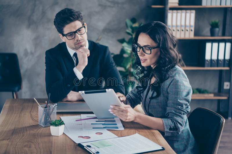 Photo of woman presenting her report about her done work to her boss with her tablet. Photo of women presenting, her report about her done work to her boss with royalty free stock photography