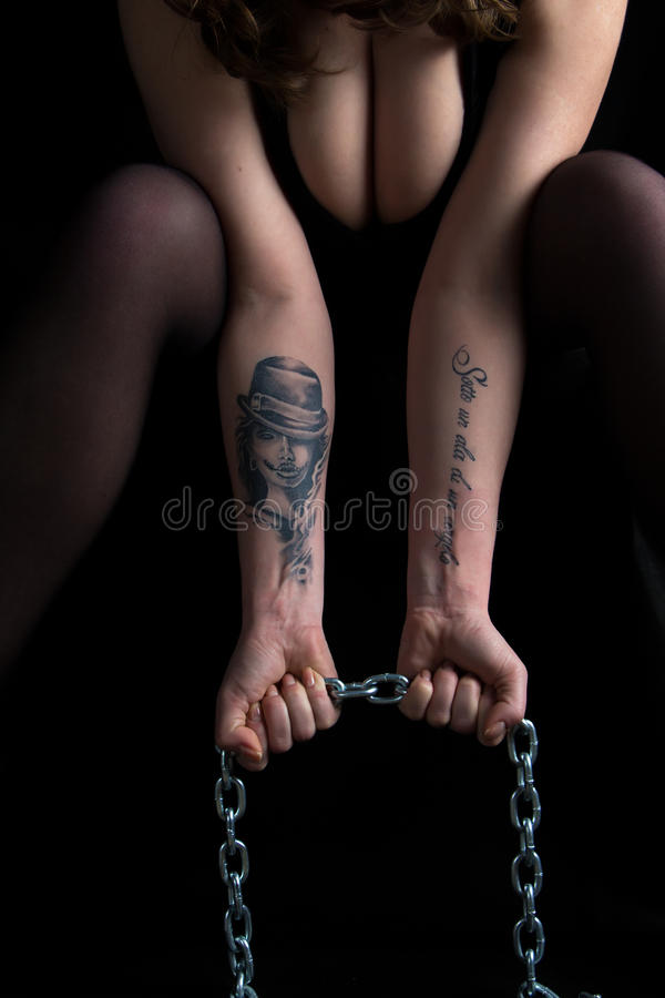 Photo woman's hands holding chain and breast royalty free stock image