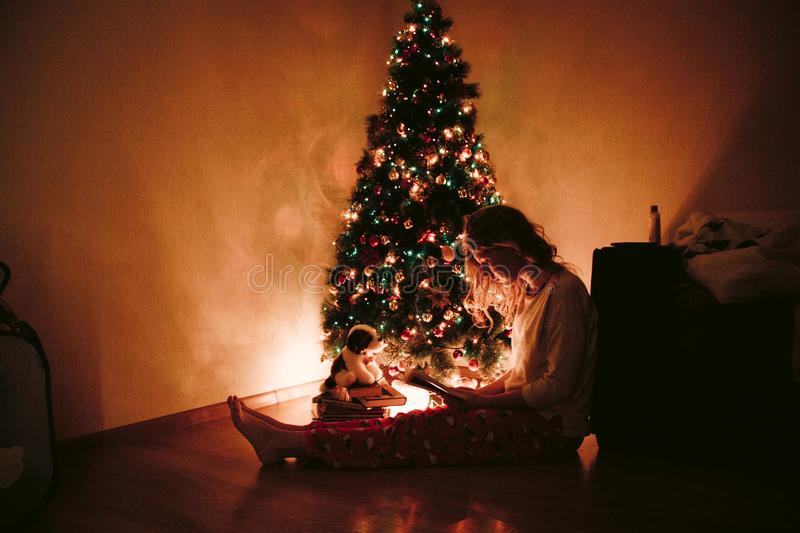 Photo of Woman Sitting Near the Christmas Tree royalty free stock image