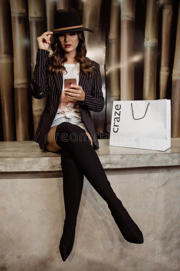 Photo of Woman Sitting Near Paper Bag royalty free stock image