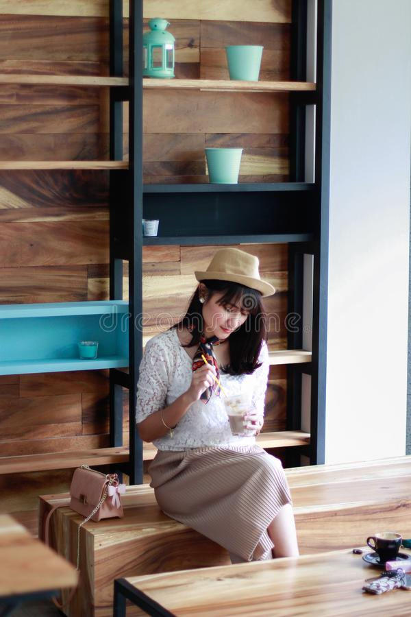 Photo of Woman Sitting on Wooden Chair stock images