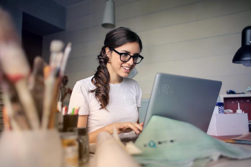 Photo of Woman Using Her Laptop royalty free stock photography