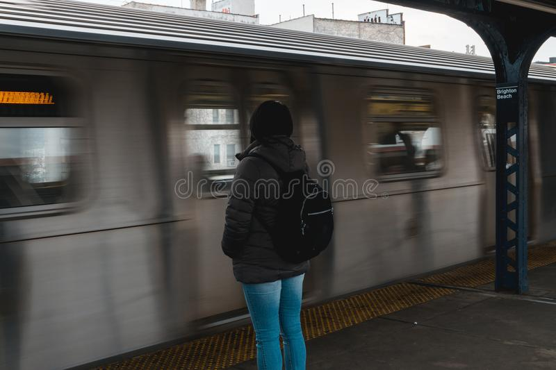 Photo of Woman Waiting at the Train Station stock photo