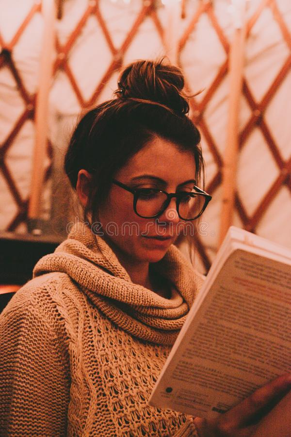 Photo of Woman Wearing Gray Scarf Reading Book stock images
