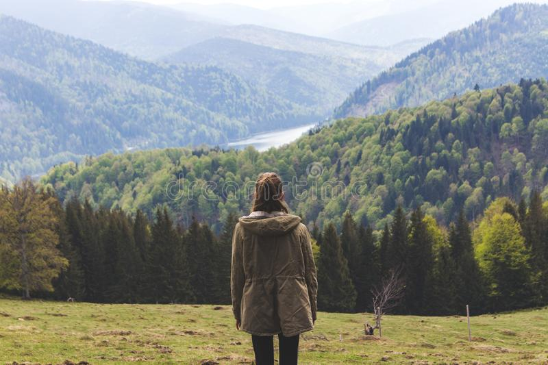 Photo of Woman Wearing Jacket Standing Near Forest Trees royalty free stock photos