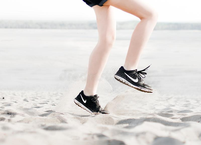 Photo of Woman Wearing Pair of Black Nike Running Shoes stock photography