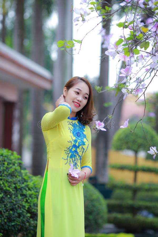 Photo of Woman Wearing Yellow and Blue Floral 3/4-sleeved Dress stock photo