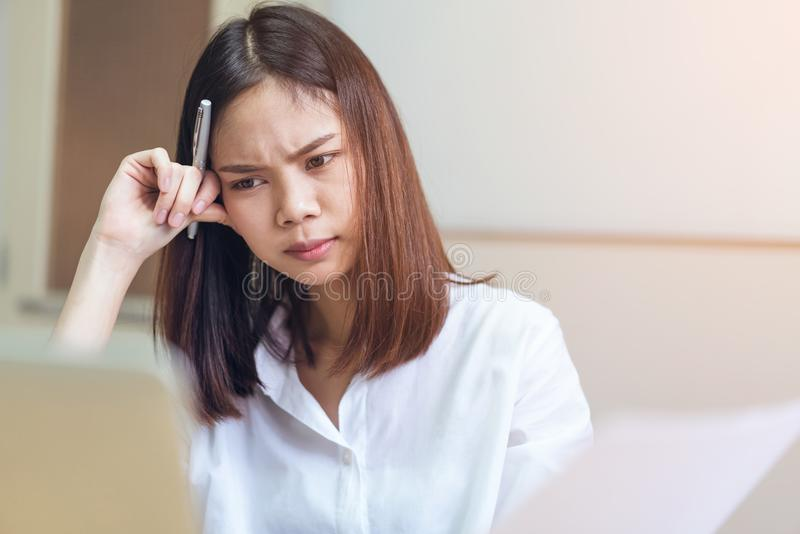 Photo of women stressed because of computer use for a long time. Photo of woman stressed because of computer use for a long time. The concept of overwork is bad royalty free stock photos