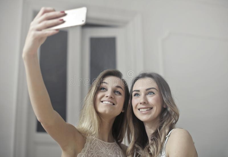 Photo of Women Taking Picture royalty free stock images