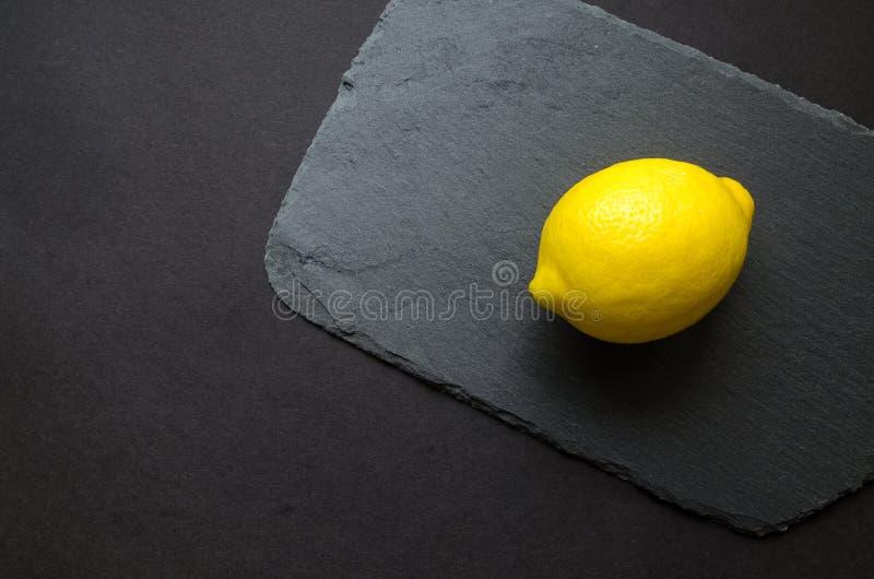 Photo of Yellow Lemon on Gray Surface royalty free stock image