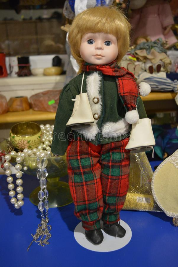 Doll of an aristocrat boy with skates royalty free stock photos