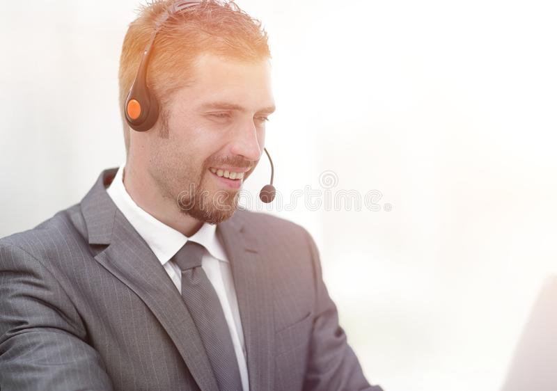 Young agent of the call center with the headphones. royalty free stock images