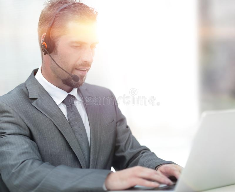 Young agent of the call center with the headphones. stock images