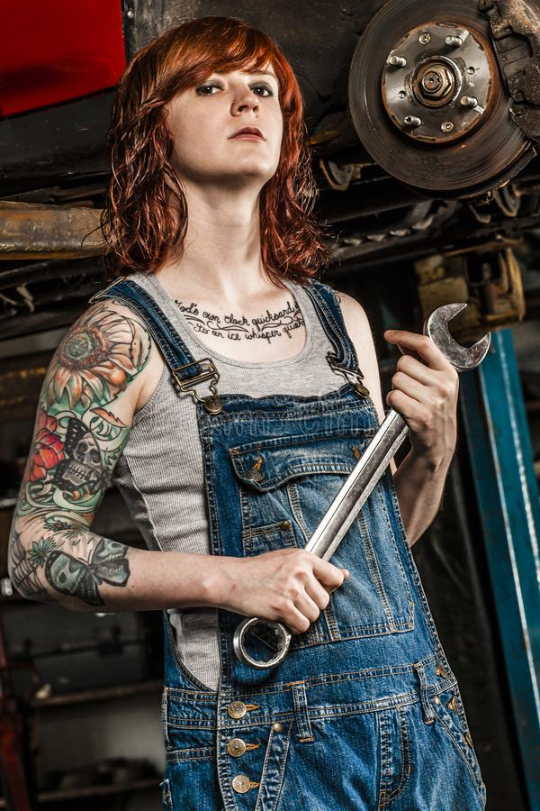 Download Beautiful Redhead Mechanic Fixing Brakes Stock Image - Image of standing, person: 107307193