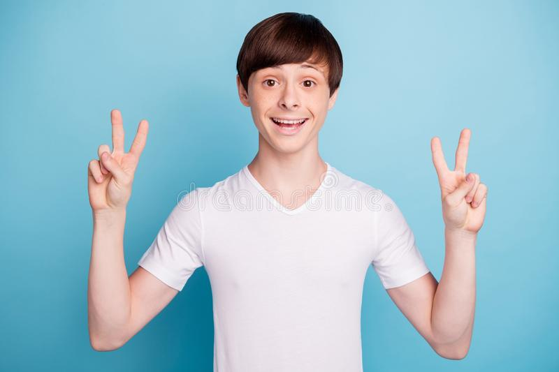Photo of young cheerful fun guy saying hi to you while isolated with blue background stock photos