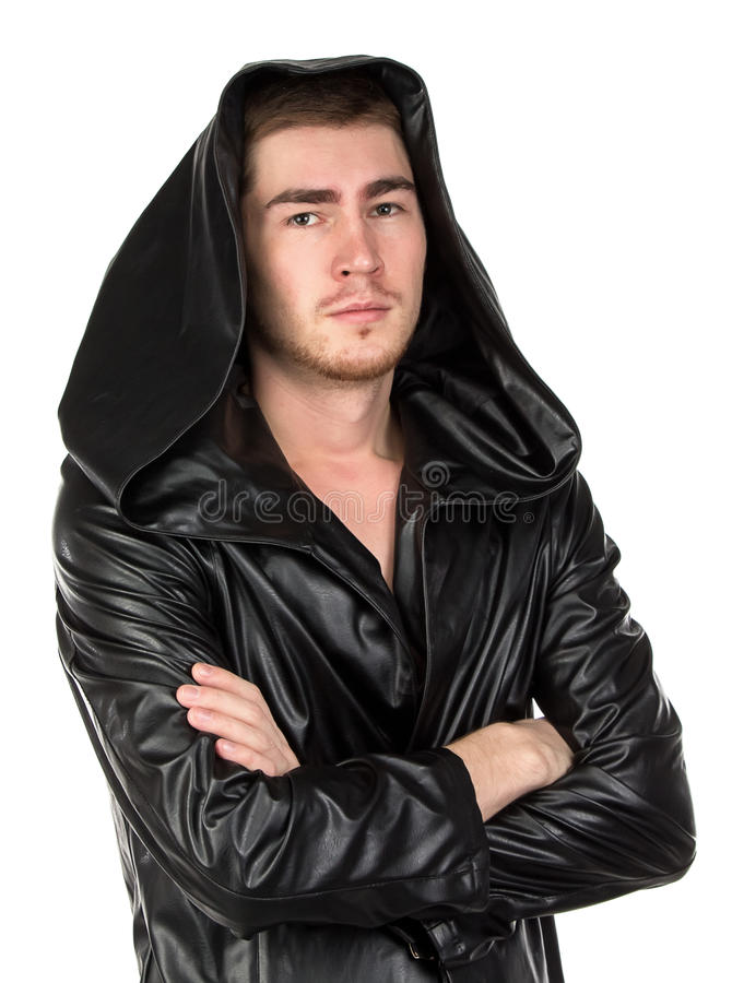Photo of the young man dressed in hooded cloak. On white background royalty free stock photo