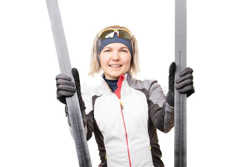 Photo of young sportswoman with skis on empty white background. stock images