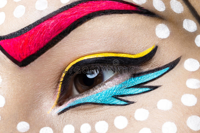 Photo of young woman with professional comic pop art make-up. Creative beauty style. Close up stock photos