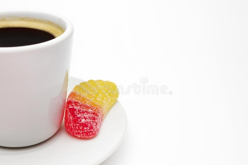 A photo of your white porcelain coffee cup, colorful yellow and red fruit jelly citrus sugar candy. Delicious black turkish coffee. Served with the ceramic cup stock photos