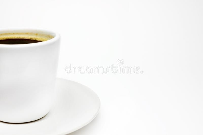 A photo of your white porcelain coffee cup on the plate with place for text, copyspace. Delicious black turkish coffee served with stock photography
