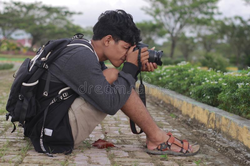 Photograper in action stock photo