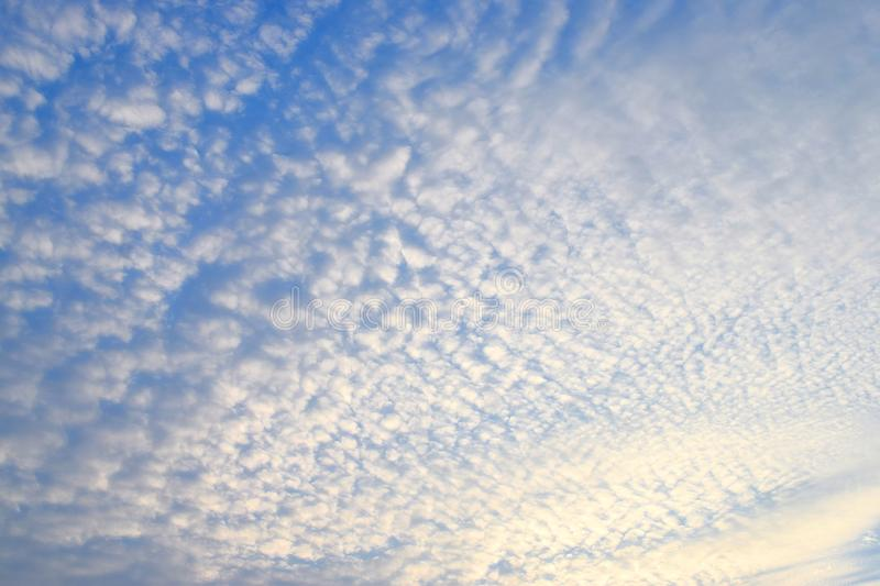 Abstract Pattern of White Cirrocumulus Clouds in Infinite Blue Sky - Natural Background stock photography