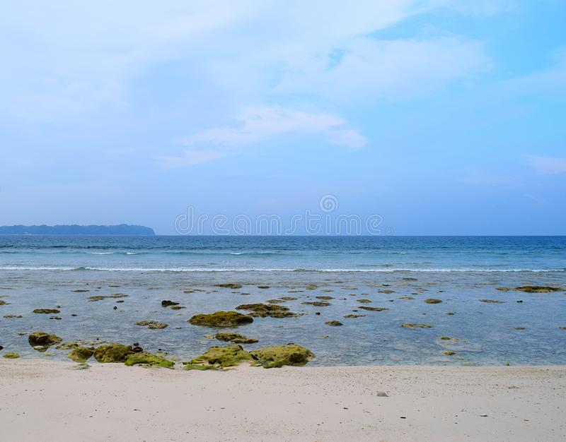 Azure Clean Sea Water at Rocky Beach and Blue Sky - Natural Background - Laxmanpur, Neil Island, Andaman Nicobar, India stock photos