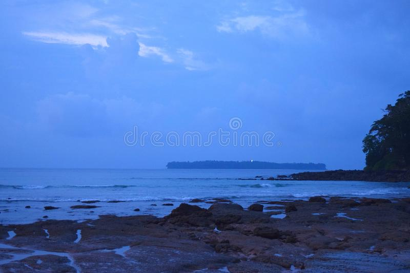 Midnight Blue Landscape - Sea, Sky, and Island - Sitapur Beach, Neil Island, Andaman Nicobar, India. This is a photograph of a beach and sky captured at dawn royalty free stock image