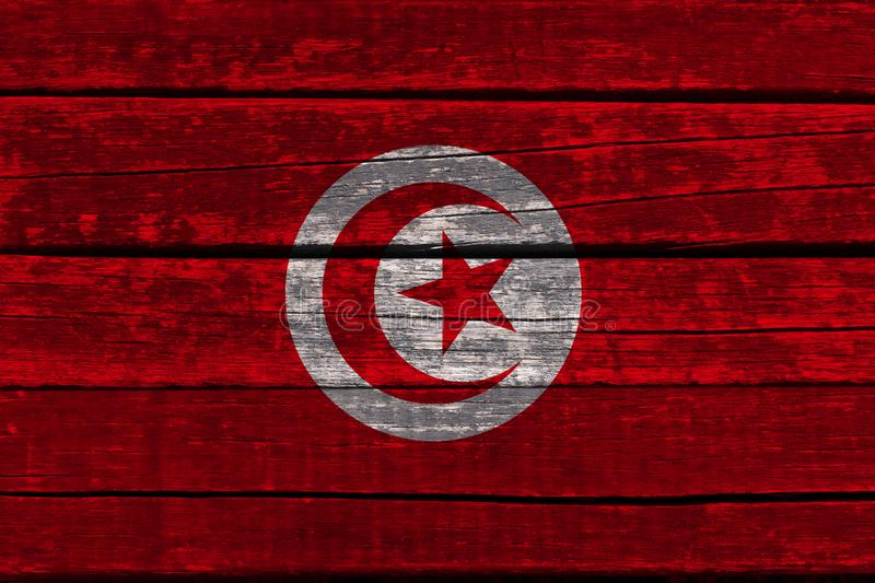 Photograph of the beautiful colored national flag of the modern African state of Tunisia on textured fabric, concept of tourism,. Emigration, economics and royalty free stock images