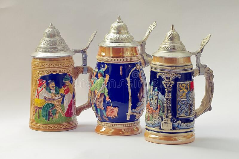 Traditional German beer mugs, expertly decorated. The photograph beautifully decorated traditional German mugs for beer royalty free stock photos